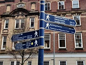 golden statue of Boulton Watt and Murdoch in Birmingham
