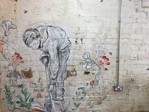 wall mural depicting man digging