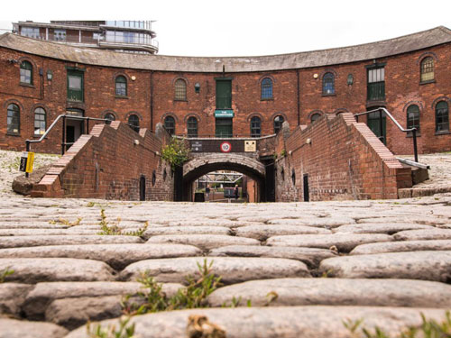 view of roundhouse and cobbled courtyard