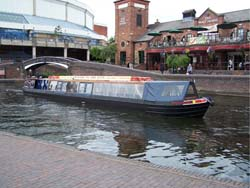 narrow boat on the canal in the centre of Birmingham near Brindley Place