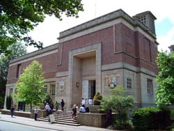 exterior view of the Barber Institute with people on the steps on a bright summer's day