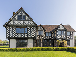 external view of the hall revealing all the patterning resulting from the timber framed construction