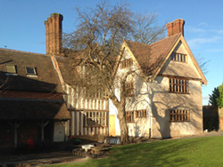 exterior view of the timber framed gables of Bells farmhouse